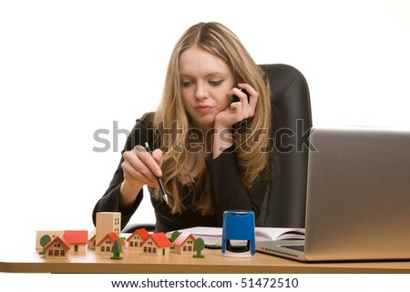 Young businesswoman writing in notebook - stock photo