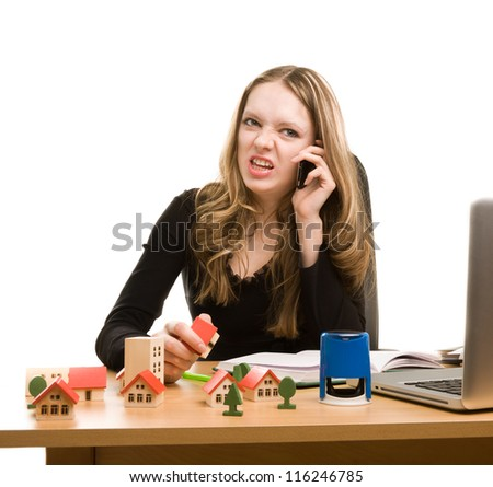 Young businesswoman writing in notebook and calling to phone - stock photo