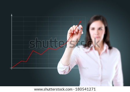 Young businesswoman writing on glass board or working with virtual screen.