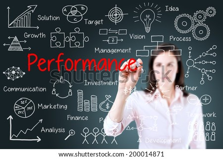 Young businesswoman writing performance business scheme. Blue background.
