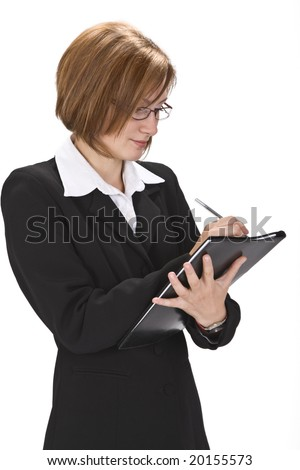 Young businesswoman writing something on a wallet isolated against a white background.