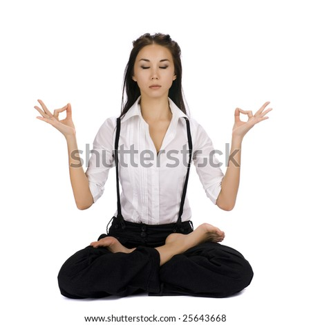 Young businesswomat doing meditation. Isolated on white - stock photo