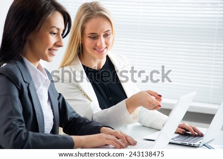 Young businesswomen at the workplace - stock photo