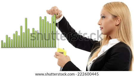Young busineswoman evaluating a chart with a measuring tape, concept image of success - stock photo