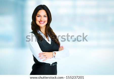 Young bussiness woman standing over office background - stock photo