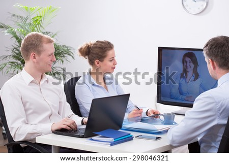 Young busy creative businesspeople and video conference - stock photo