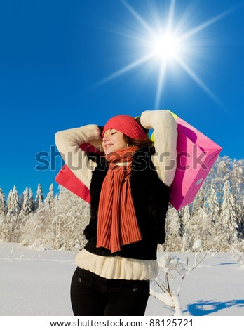 Young Buyer Enjoying the Snow - stock photo