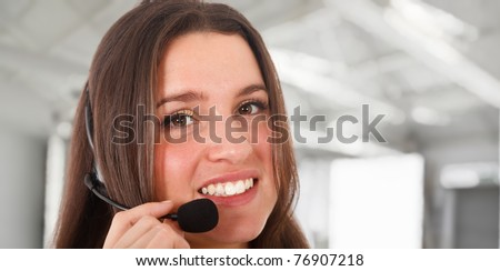 Young call center operator - stock photo