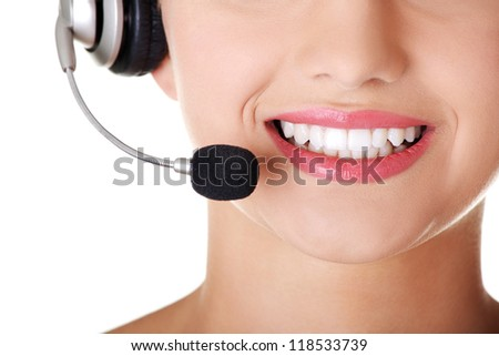 Young call-centre assistant smiling at the camera , isolated - stock photo