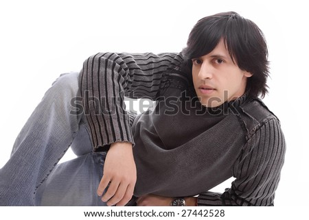 Young casual boy posing isolated over white