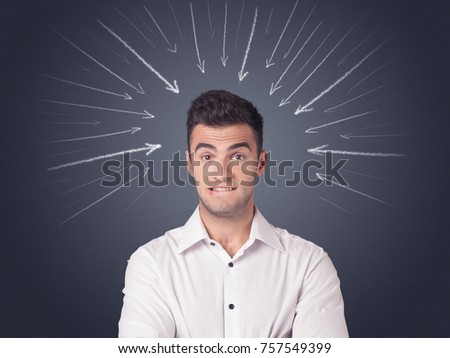 Young casual businessman with arrows pointing to his head