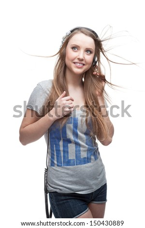 young casual caucasian girl with headphones listening to music isolated on white