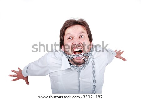 Young casual caucasian man chained and screaming - stock photo