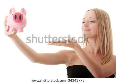 Young casual caucasian woman holding piggy-bank isolated on white background - stock photo