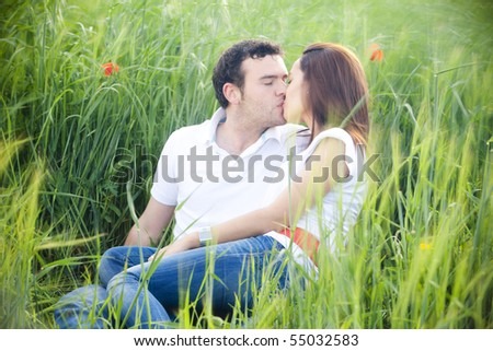 Young casual couple feeling each other - stock photo