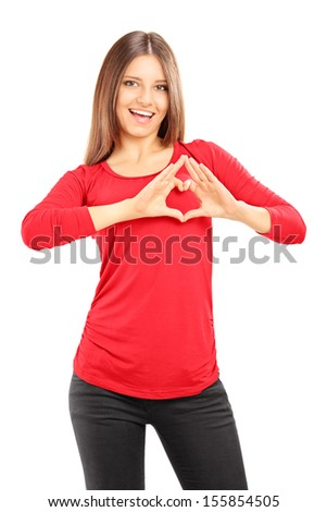 Young casual female with her hands in the form of heart isolated on white background