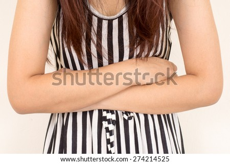 Young casual girl woman is having stomach ache - stock photo