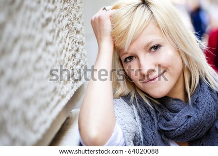Young casual looking girl staring at camera. - stock photo