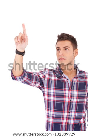 young casual ma selecting or pushing a button over white background - stock photo