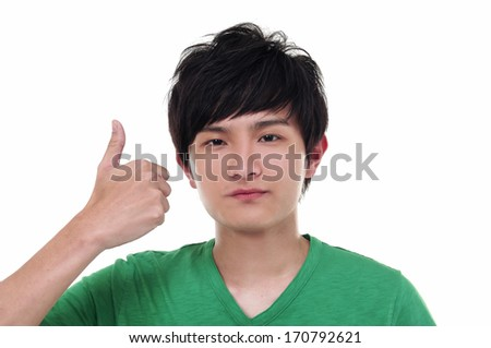 young casual man going thumb up, isolated on white - stock photo