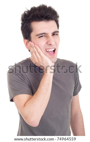 young casual man having a toothache isolated on white background - stock photo