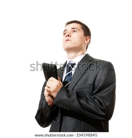 young casual man holding purse and asking salary money, isolated - stock photo