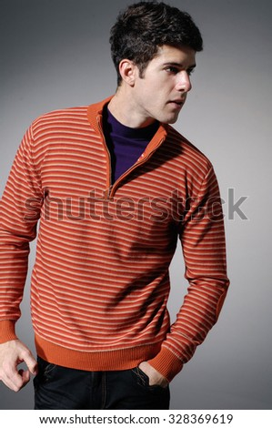 young casual man in sweater dress portrait - stock photo