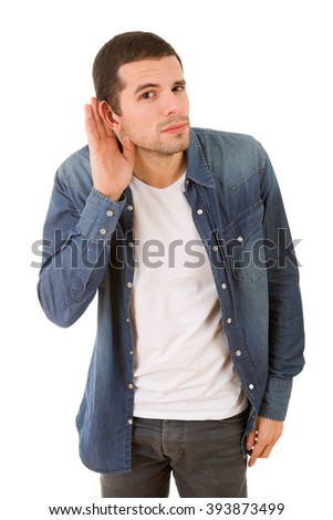 young casual man listening in white background - stock photo