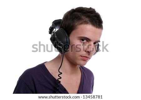 young casual man, listening to music, isolated in white background - stock photo