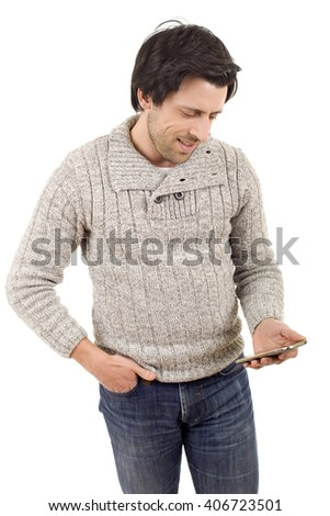 young casual man looking to his phone, isolated