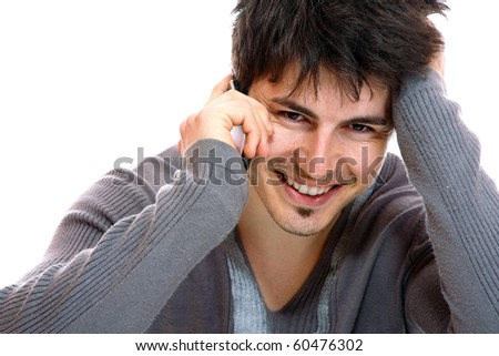 Young casual man on the phone isolated over white background - stock photo
