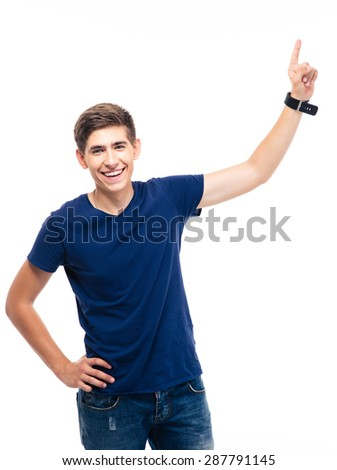 Young casual man pointing finger up isolated on a white background and looking at camera - stock photo