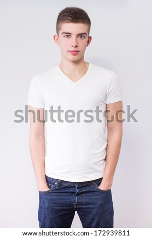 young casual man portrait, hands in pockets