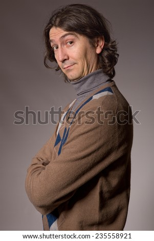 young casual man portrait in a dark background - stock photo