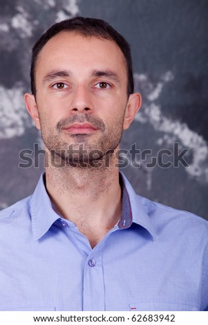 young casual man portrait on a dark background - stock photo
