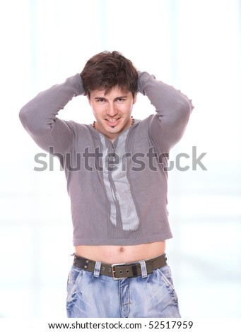 Young casual man portrait over abstract background