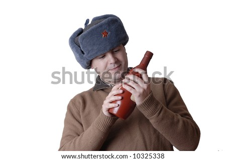 young casual man portrait with a russian hat and a red bottle