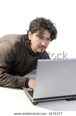 young casual man portrait with personal computer