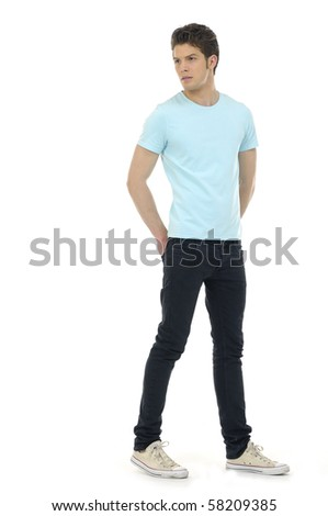 young Casual man posing in studio - stock photo