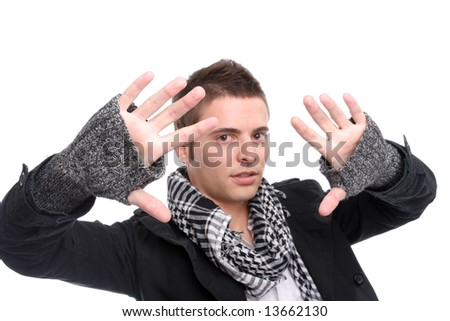 Young casual man posing, isolated in white background - focus on the man's hands