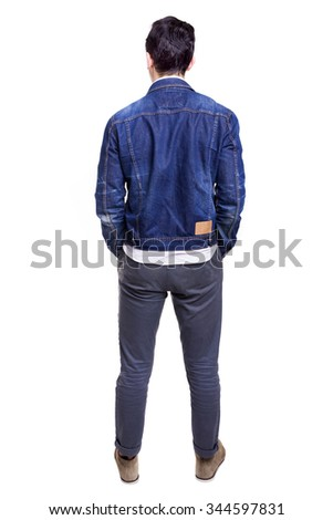 Young casual man standing from back, isolated on white background - stock photo