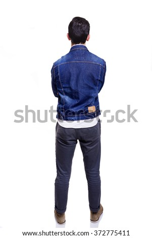 Young casual man standing from back with arms crossed, isolated on white background - stock photo