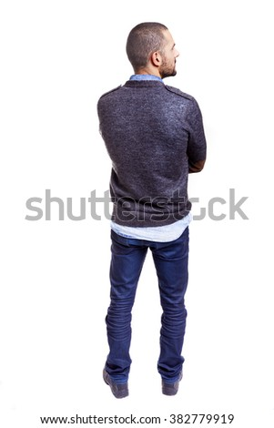 Young casual man standing from back with arms crossed, isolated on white background