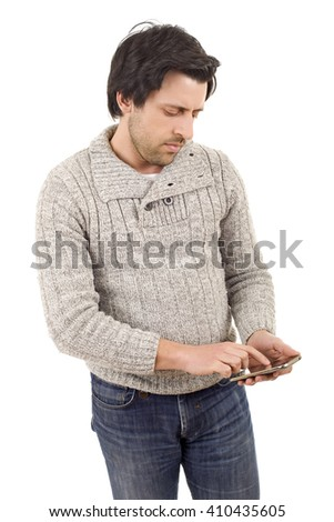 young casual man with a phone, isolated