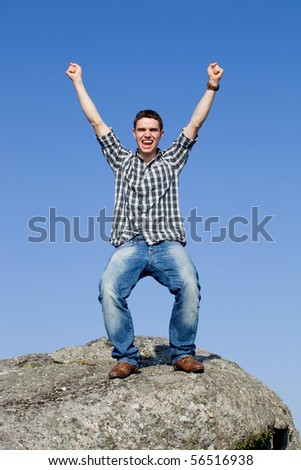 young casual man with the sky as background - stock photo