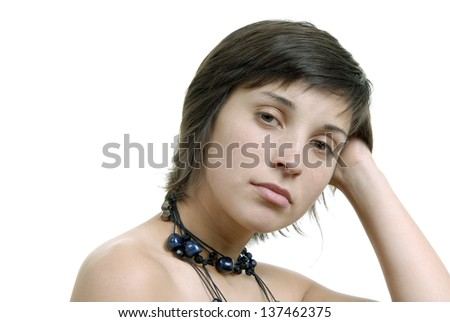 young casual sad beautiful woman, isolated in white - stock photo