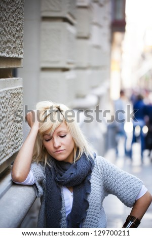Young casual urban girl with sad expression - stock photo