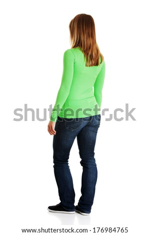 Young casual woman from behind, isolated on white  - stock photo