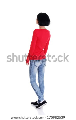 Young casual woman from behind looking up, isolated on white