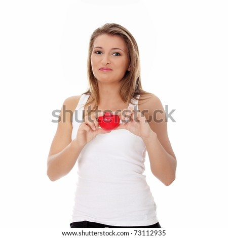 Young casual woman holding red heart, isolated on white